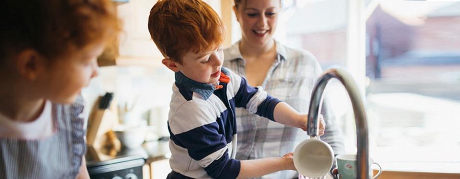 Boy washing dishes